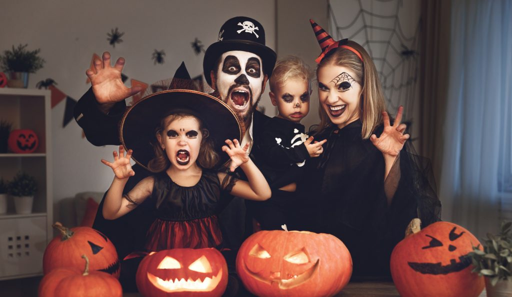 happy family dressed up for halloween