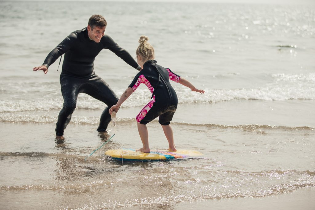 little girl learning to surf
